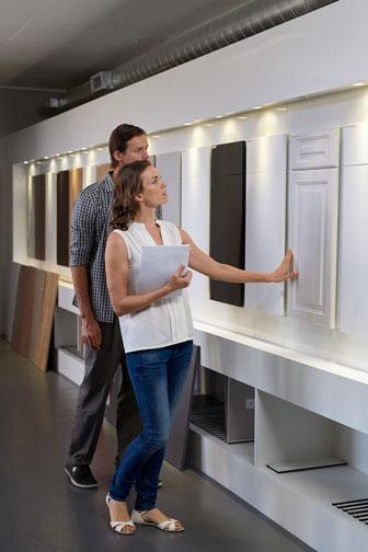 young couple choosing kitchen cabinet doors