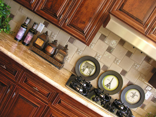 wood kitchen cabinets with granite countertop and tile backsplash